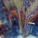 wood ash over copper glaze