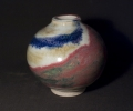 """small jar 4.5"""" tall, stoneware with Cobalt and copper under glaze brush work."""